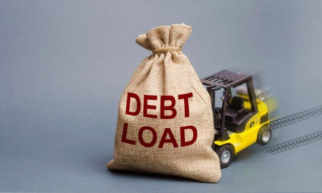 Машинка и мешочек с надписью DEBT LOAD